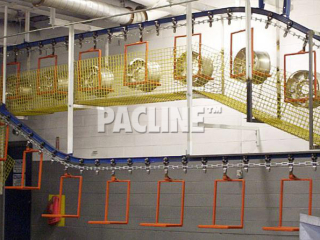 Pacline I-beam conveyor used to transport wheel rims through wash process before electroplating.