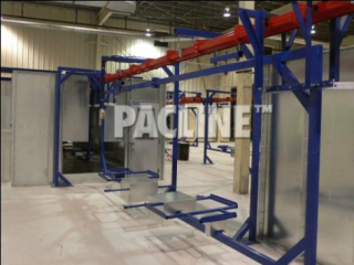 This PAC-MAX overhead monorail conveyor is set up to move carriers for large parts through a wet painting process.