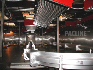 Sideways enclosed track conveyor for finishing automotive rims on rotatable spindles, S-60 heavy duty conveyor.