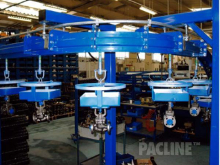 Overhead conveyor PAC-MAX carries industrial valves through paint line process.