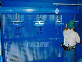 Hydraulic valves are moved through hand spray paint process using a heavy duty PAC-MAX conveyor.