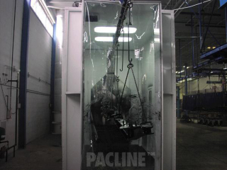 I-beam conveyor with indexing hooks used in the paint finishing of heavy truck suspension components.