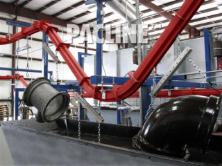 PAC-MAX conveyor can handle sharp inclines to carry these heavy pipe fittings through paint dip line.
