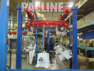 This heavy duty overhead conveyor moves products with various sizes and weight through painting and curing stages.