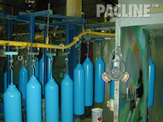 The PAC-LINE™ overhead conveyor for paint finishing of heavy gas bottles on rotating carriers.