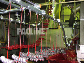 The PACLINE enclosed track conveyor. Dip paint finishing of lifting hooks in confined area with steep elevation.