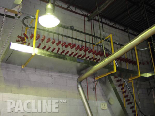 The PAC-LINE™ overhead conveyor with sheet metal guarding for small parts and to catch any paint drippings.