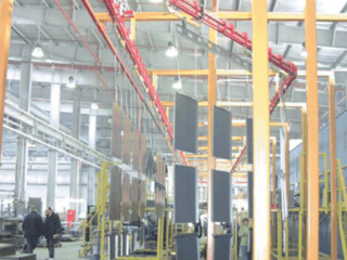 Powder coating of safe components using long load bars and bias banking for storage, S-310 Power and Free conveyor.
