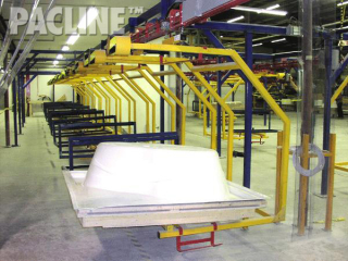 Timed curing accumulation on power and free conveyor system for large bathtubs.