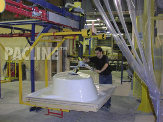 Unloading of bathtubs from S-310 power and free overhead conveyor system.