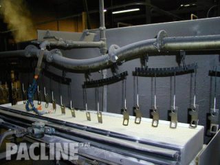 The PAC-LINE™ overhead conveyor system dip coating through liquidized bed for seat belt components.