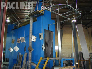 Locker storage components get powder coating treatment while on an overhead conveyor system.
