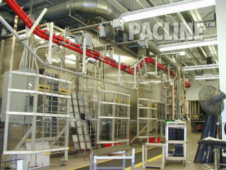 Plastics finishing of auto parts using a power and free overhead conveyor.