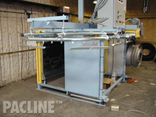 A compact conveyor for the painting of truck rims.