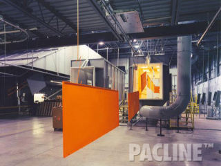 Powder coat finishing of panels for metal cabinets using the PAC-LINE™ overhead conveyor system.