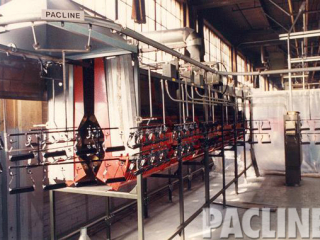 PACLINE overhead conveyor system for paint finishing of small metal parts using track type carriers.
