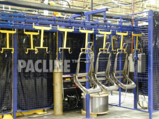 Automotive seats being accumulated while cooling, using power and free overhead conveyor system.