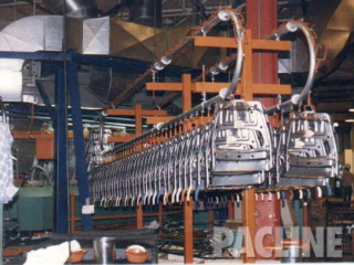 Enclosed track over and under manual conveyor used for automotive part accumulation.