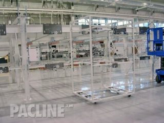 This view of an empty gravity flow conveyor reveals a mobile cart at one of the many docking stations.