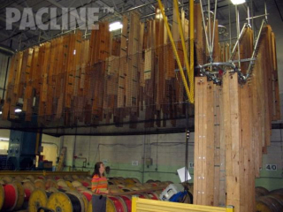 The PAC-LINE™ overhead conveyor moves long electric harness templates up in to the ceiling area for storage.