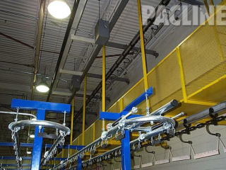 Buffer storage of paint racks with 9 inch radius curves, utilize a floor mounted overhead conveyor system.