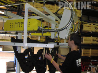 Buffer storage of paint racks with 9 inch radius curves, floor supported overhead conveyor system.