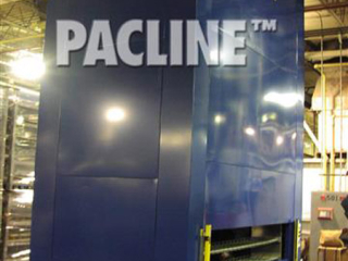 Pacline vertical carousel is used to accumulate and hold hot cast aluminum parts while cooling.