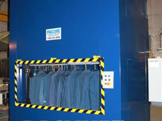 Vertical conveyors have many application uses, for example placing work uniforms in an automated storage system.