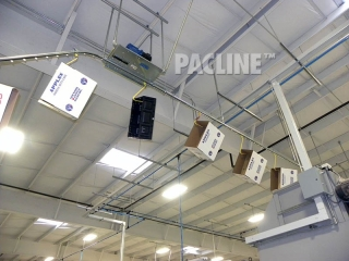 Conveyor installed in ceiling area of produce packing shed.