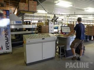 Produce sorting equipment with overhead conveyor.