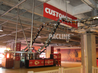 PACLINE conveyor moves clothing from floor level to ceiling level leaving floor clear of supports and equipment.