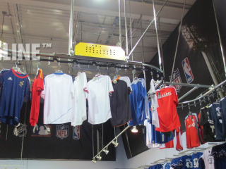 Garment handling conveyor from PACLINE can be used to store inventory and display clothing at the same time.