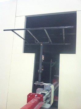 Side mounted heavy duty conveyor with rotators