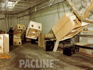 PACLINE overhead conveyor transfers large wood furniture cabinets through finishing line leaving floor space clear.