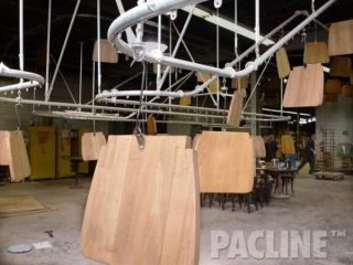 PACLINE's rotating carrier allows for easy access to all areas of wood part during finishing.