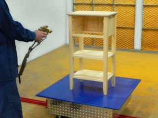 Towline conveyor cart has rotating top to allow access to all sides of furniture during paint finishing process.