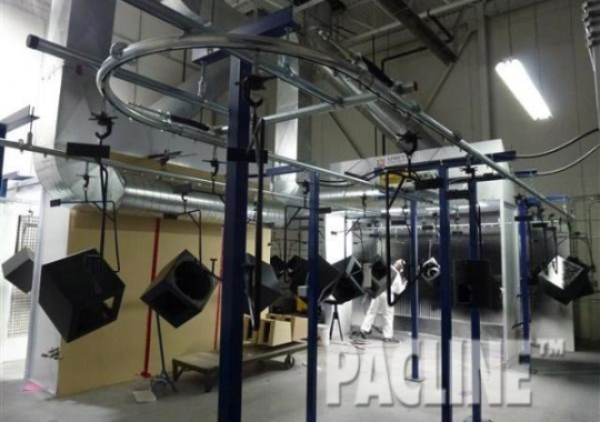 High Quality Wood Speaker Manufacturer uses the PAC-LINE™ enclosed track conveyor for their Wet Spray application.