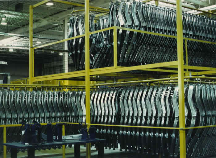 Overhead conveyor for automotive parts accumulation