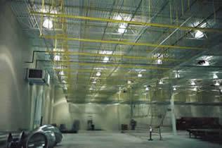 Parts storage conveyor installed in unused overhead space