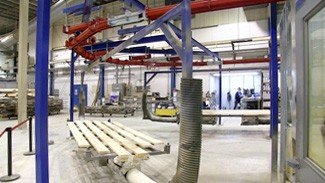 Conveyor Handles Long Parts Through Specialized Paint Process