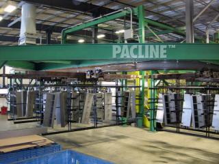 Custom trolleys designed for transferring steel panels through chemical wash on I beam conveyor system.