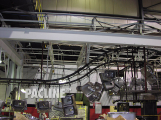 Manufacturer uses I beam conveyor to transfer stainless steel sinks through cleaning system.