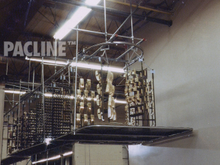 Overhead conveyor system handles commercial door parts through electroplating process.