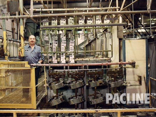 Overhead conveyor for metal finishing process