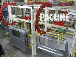 Power and free overhead conveyor system used to accumulate auto body panels in assembly operation.