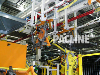 Cooling and transfer of engine cradles during welding process using power and free conveyor with robotic load and unload.