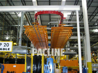 Empty carriers on conveyor system designed to transfer and accumulate engine cradles during welding process.