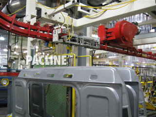 Overhead power and free conveyor for buffering truck body panels between processes.