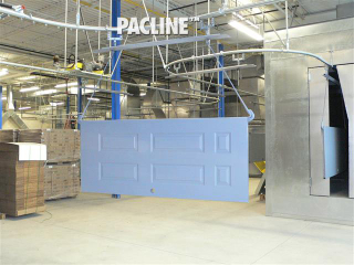 Wooden doors transferred through paint finishing line on enclosed track overhead conveyor.