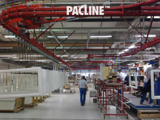 Paint finishing line for wooden doors and window frames uses power and free conveyor system.